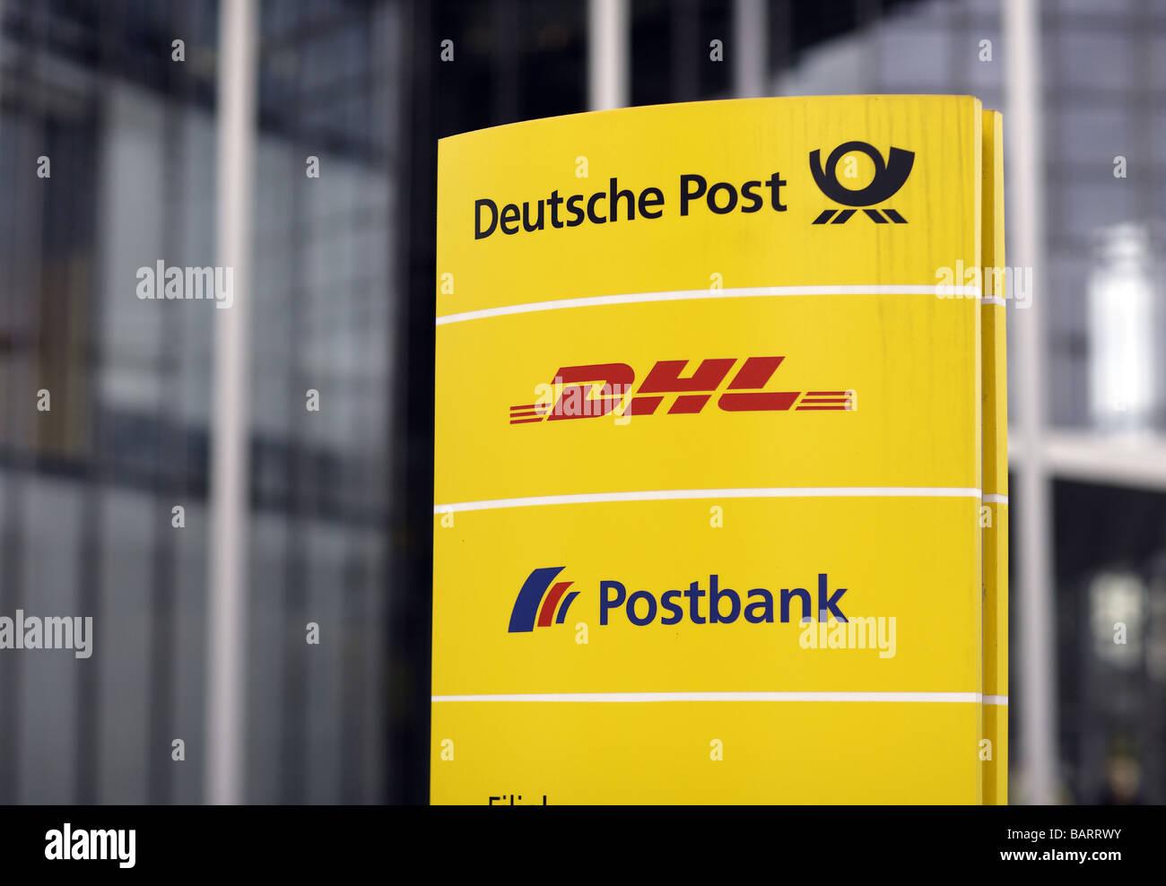 Logos Deutsche Post DHL Postbank Stock Photo