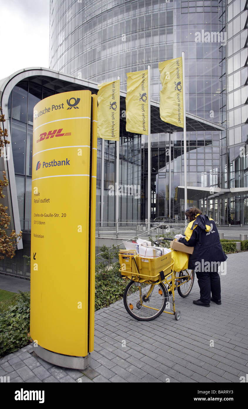 Mail carrier in front of headquarters of Deutsche Post AG Bonn Germany Stock Photo