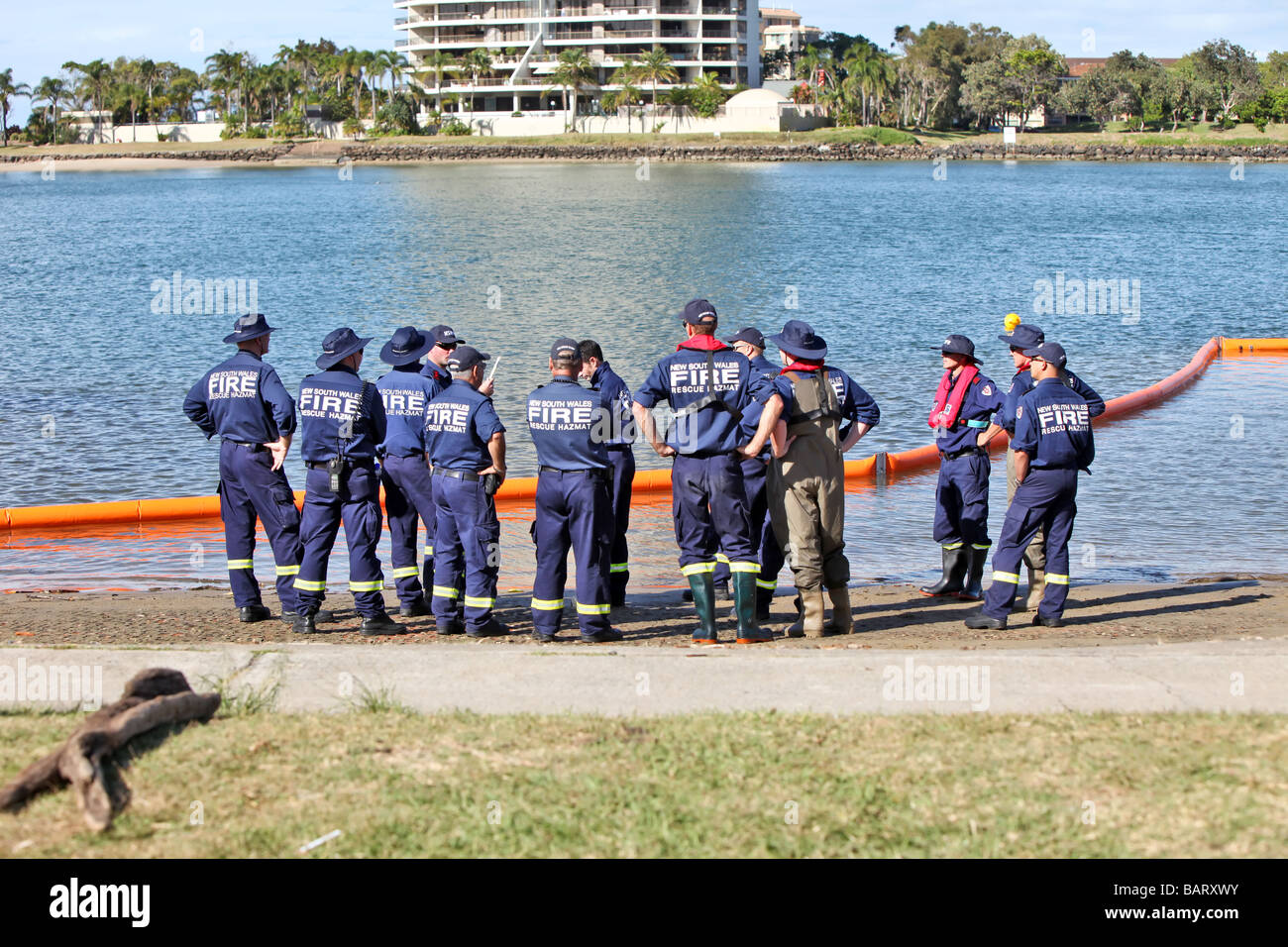 Emergency service personnel undergoing training for hazardous material and water - Stock Image