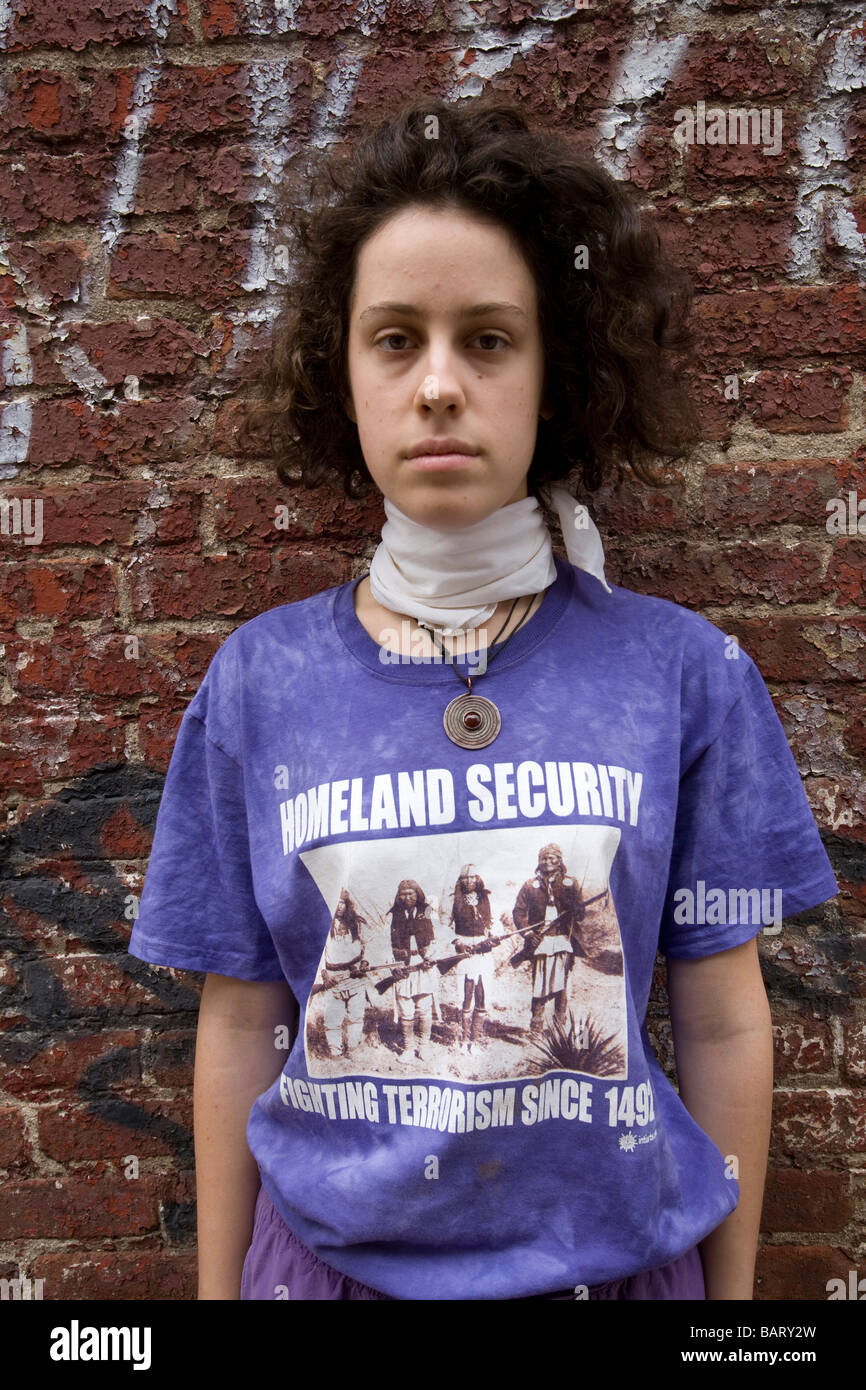 """Teenager wears a t-shirt that is a Native American response to 9/11. """"Homeland Security"""" """"Fighting Terrorism Since Stock Photo"""