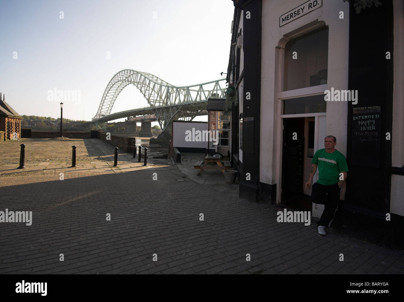 Pub in Widnes ,next to the Silver Jubilee Bridge over the River Mersey and Manchester Ship Canal at Runcorn Gap, Stock Photo