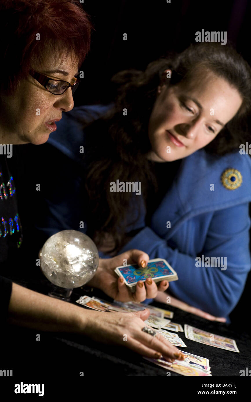 Psychic Sisters Nina Ashby (left) fortune reading in Selfridges, London - Stock Image