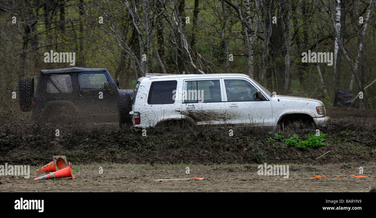 Jeep trucks competing in mud racing at Vermonster Mud Bog - Stock Image