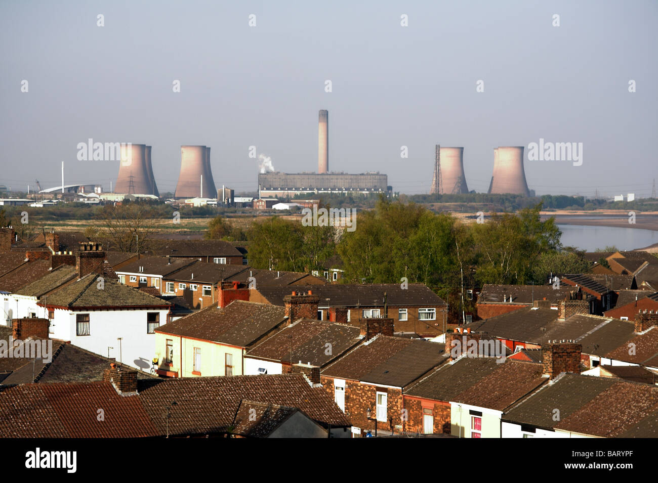 View from Runcorn Bridge over Widnes, to Fiddlers Ferry Power Station, Cheshire, UK - Stock Image