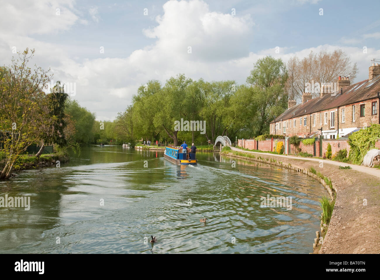 Narrowboat cruising along the River Thames at Osney in Oxford Uk - Stock Image