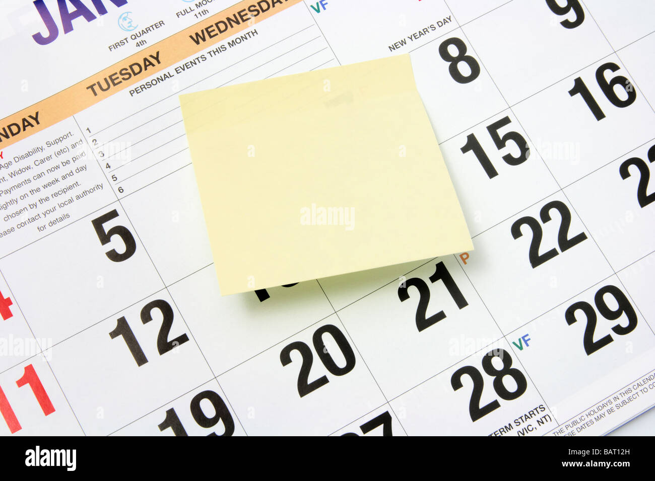 Post It Note on Calendar - Stock Image