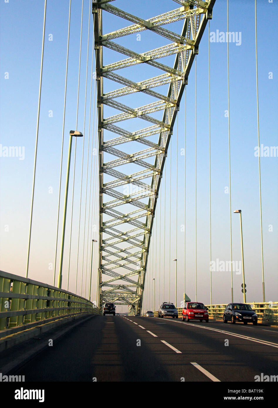 Motorists on  the Silver Jubilee Bridge over the River Mersey and Manchester Ship Canal at Runcorn Gap, Cheshire, - Stock Image