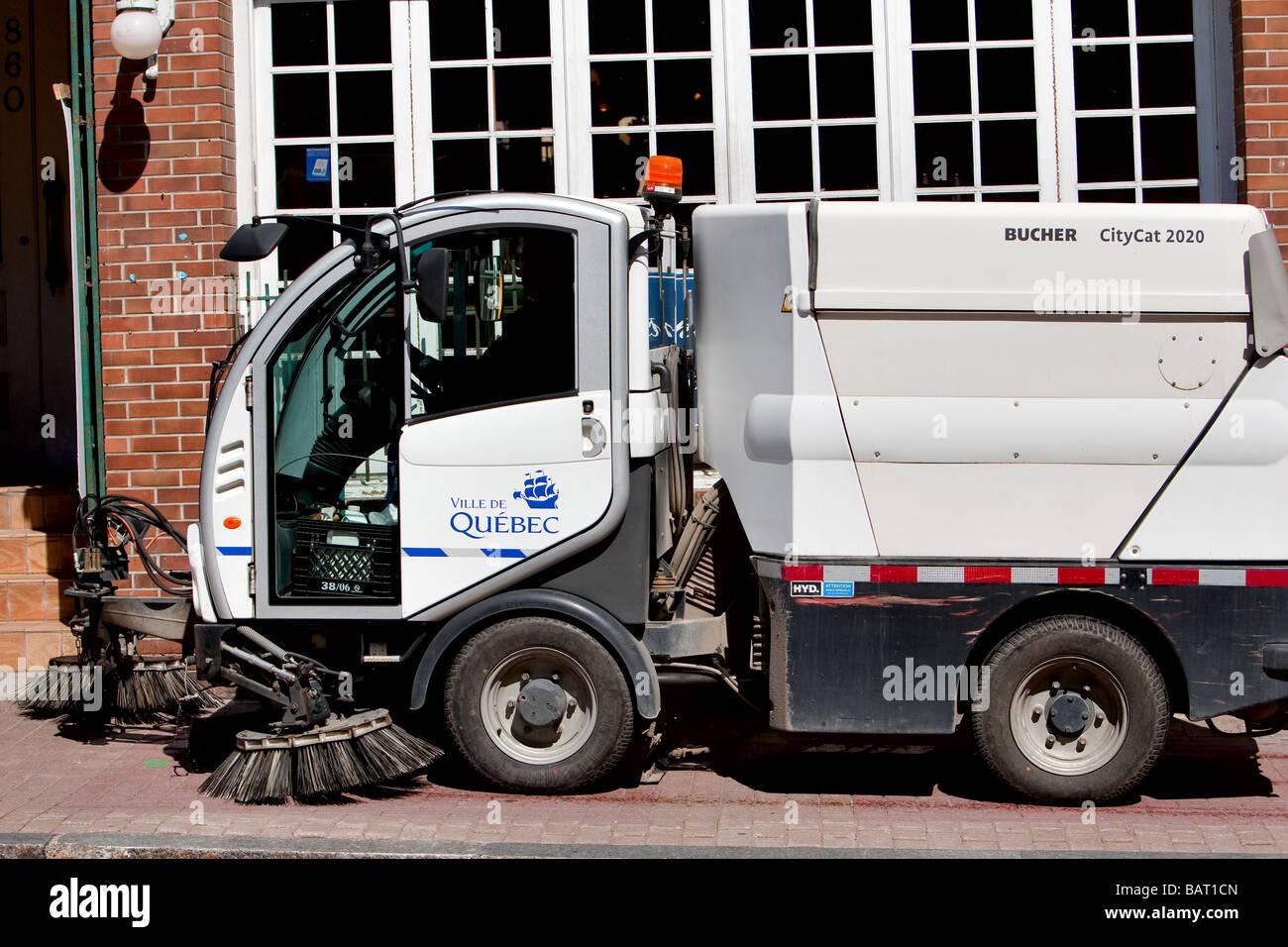 A Bucher Citycat 2020 street washer is seen on the rue St Jean street sidewalk in Quebec city - Stock Image