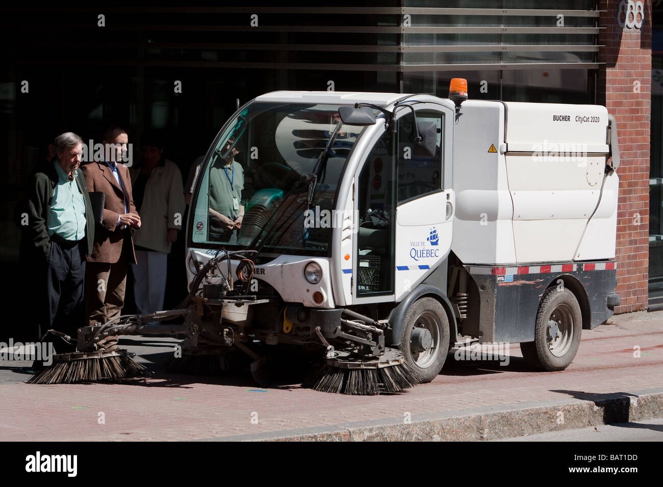 A Bucher Citycat 2020 street washer is seen on the rue St Jean street sidewalk in Quebec city Stock Photo