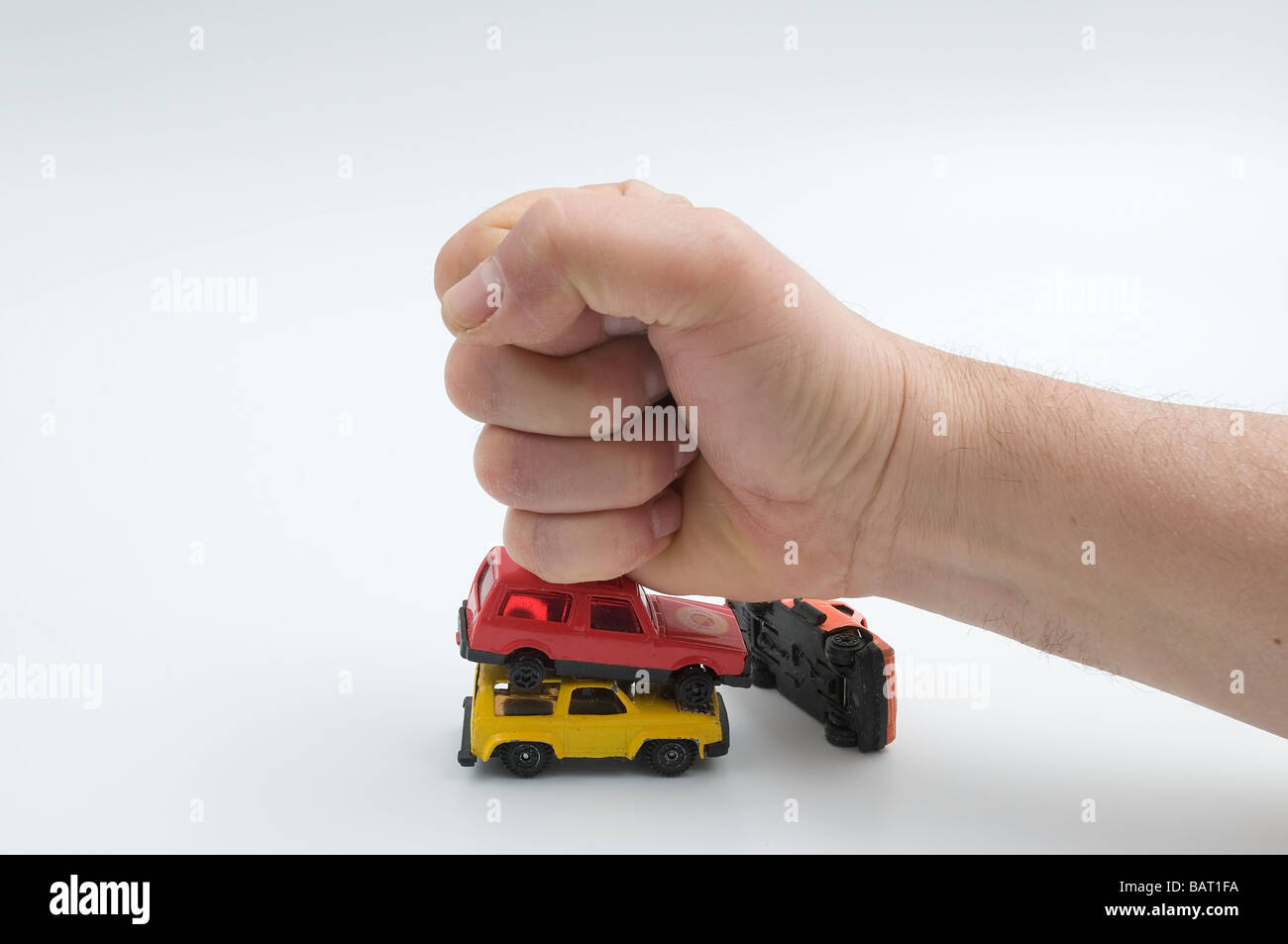 crash the cars with a fist - Stock Image
