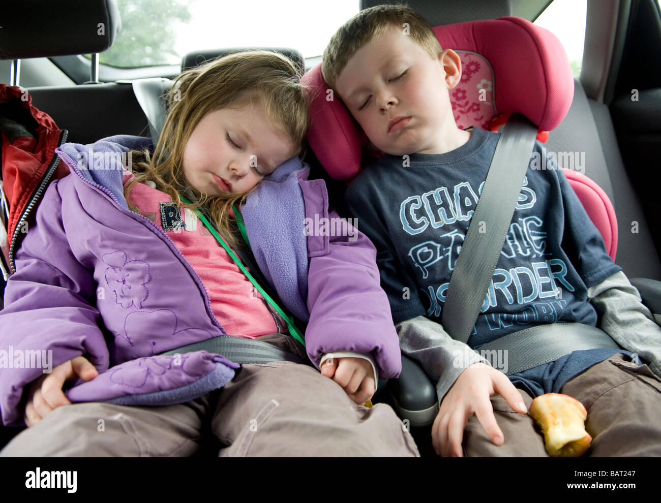 Children Sleeping In Car Seats The Back Of A On Journey From Day Out