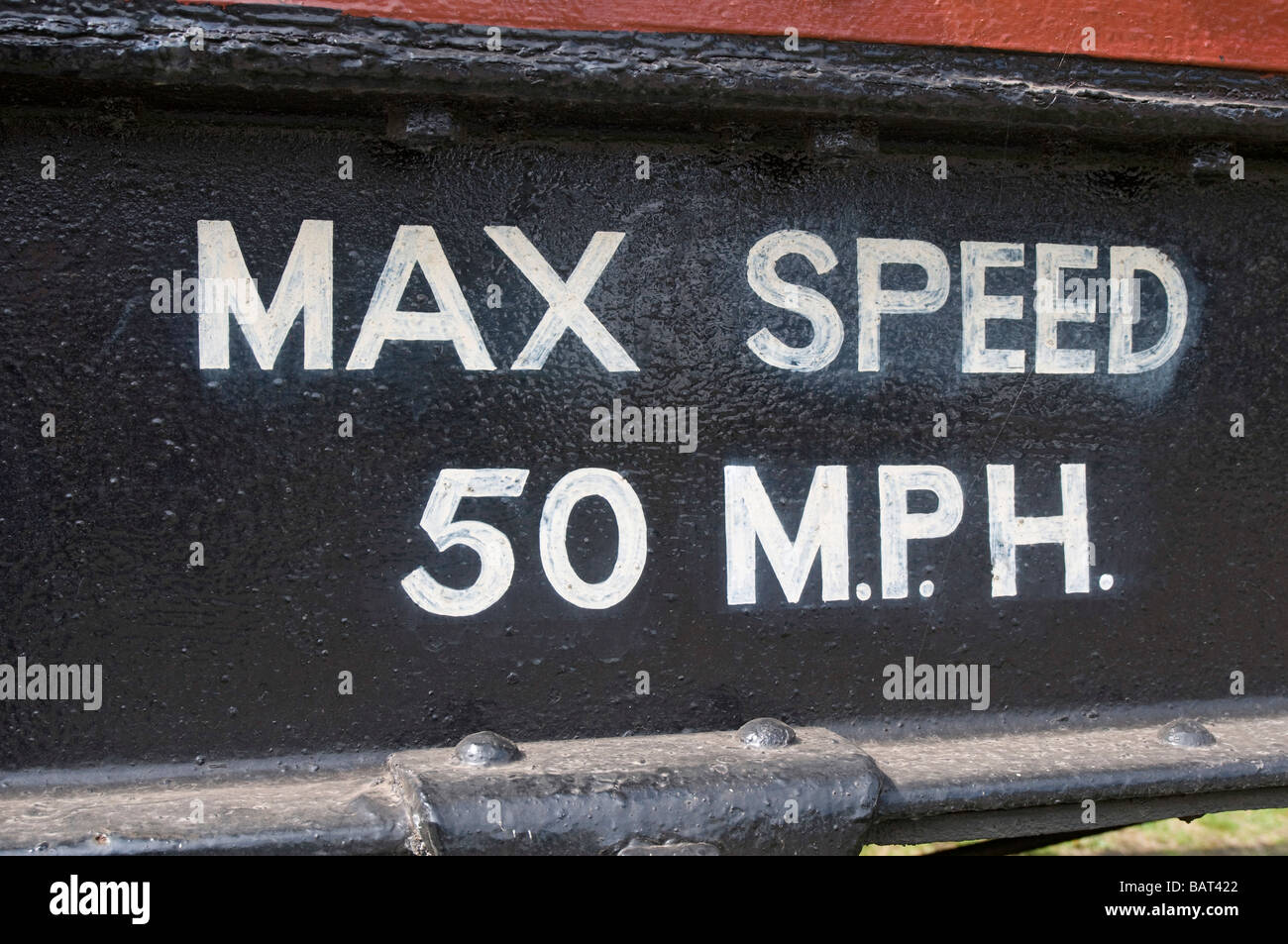 Sign on side of train advising safety advice max speed 50 MPH Stock Photo
