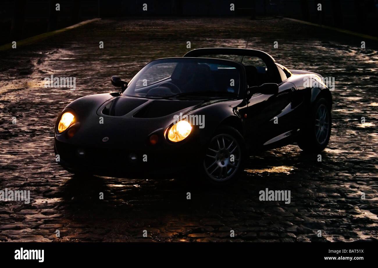 Lotus Elise S1 mk1 on cobbles - Stock Image