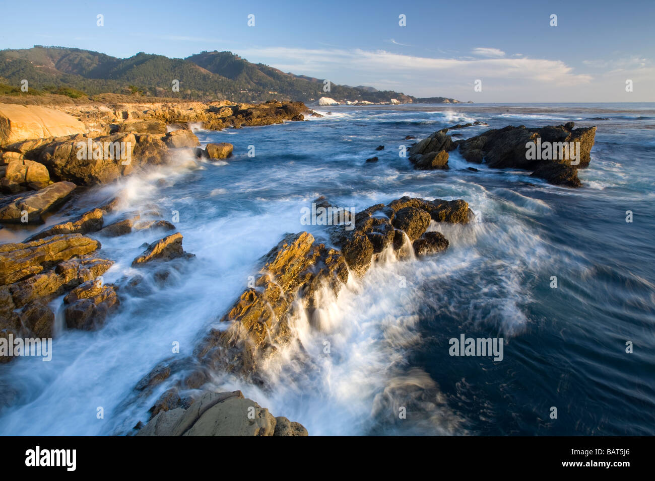 Waves crash along the rocky shores of Point Lobos State Park, CA. - Stock Image