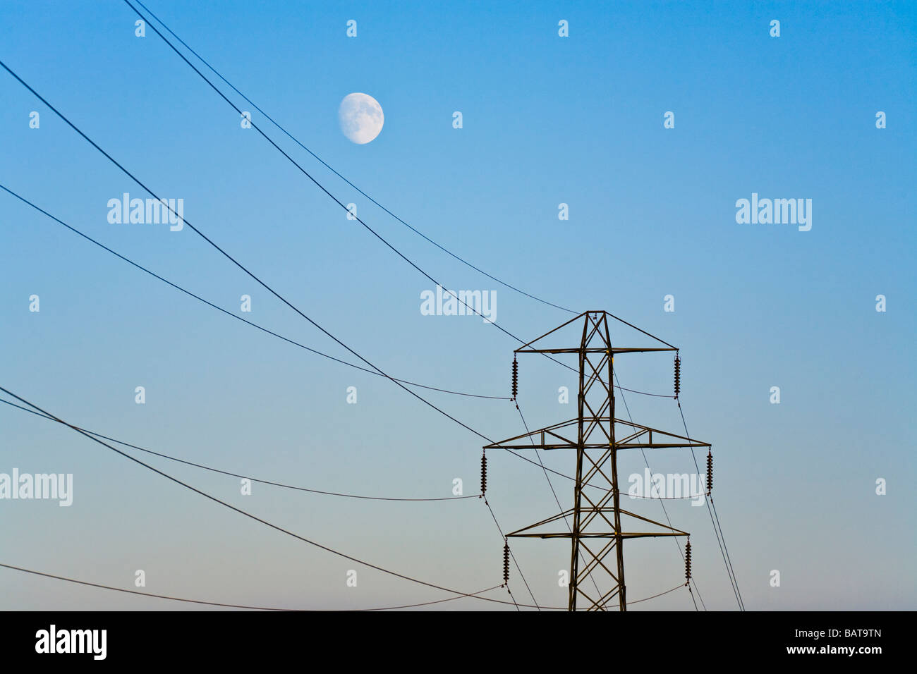 The moon rising over a pylon in Gloucestershire - Stock Image