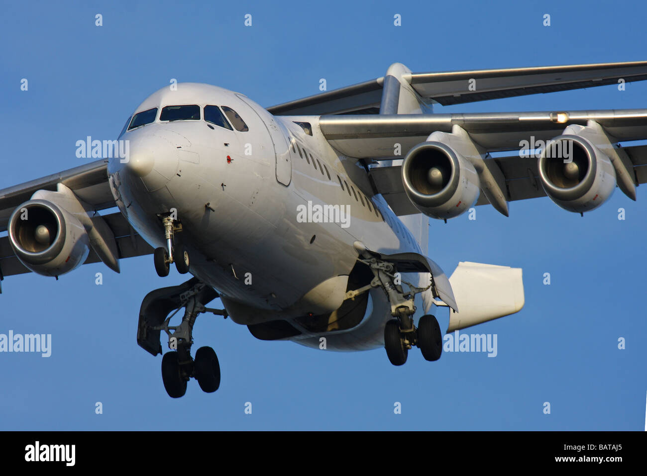 Passanger aircraft landing on London City Airport - Stock Image