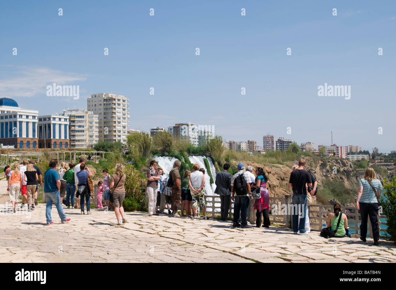 Turkey Antalya Lower Duden River as it plunges into the mediterranean sea Tourists viewing the waterfall - Stock Image