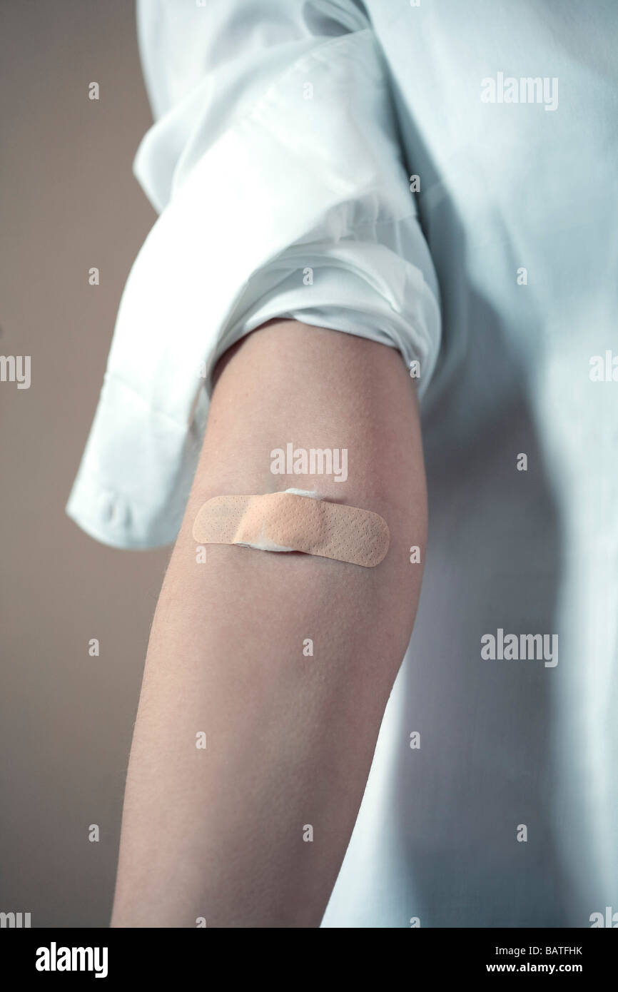 band-aid on a young woman's arm Stock Photo