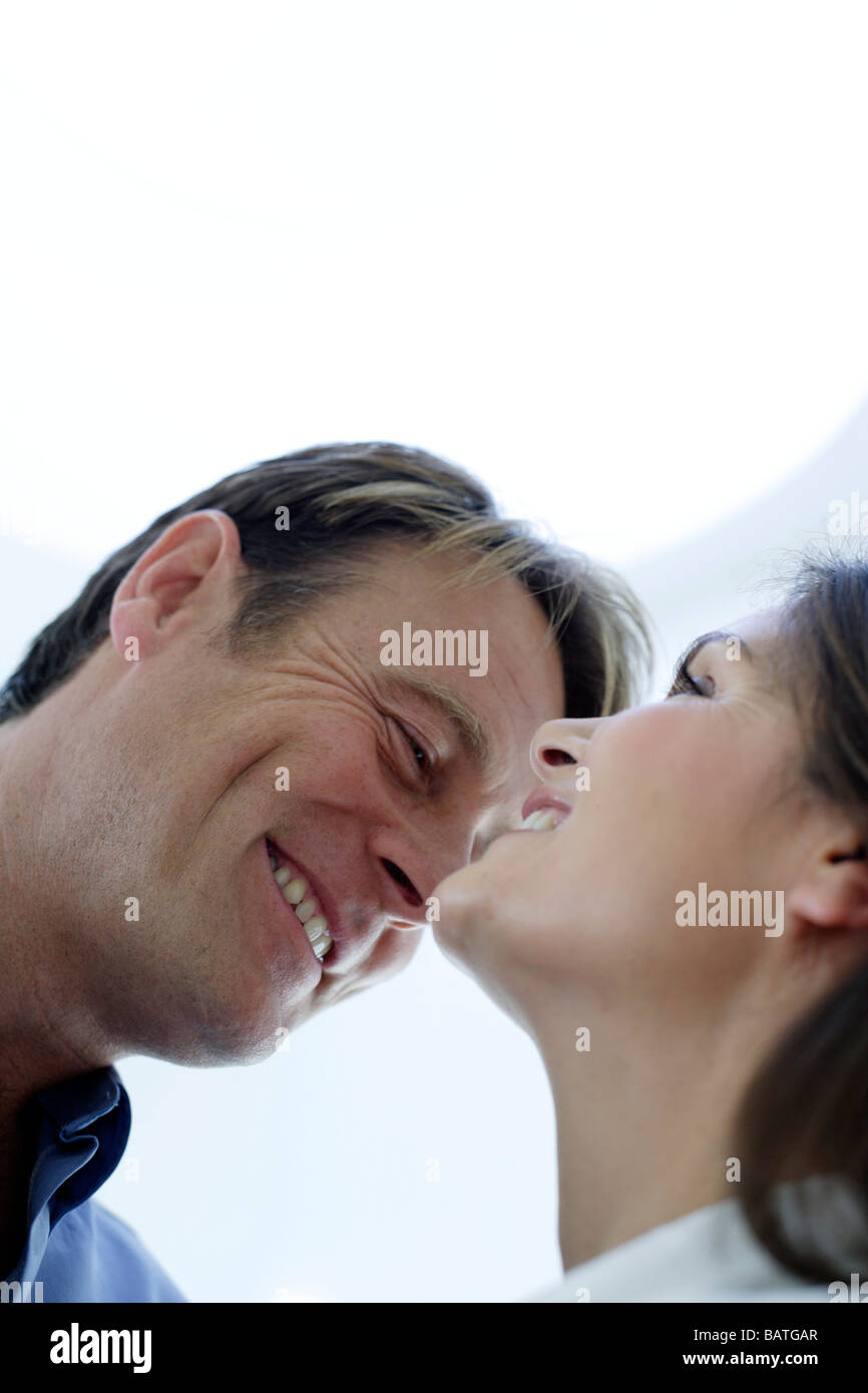 Happy couple laughing. - Stock Image