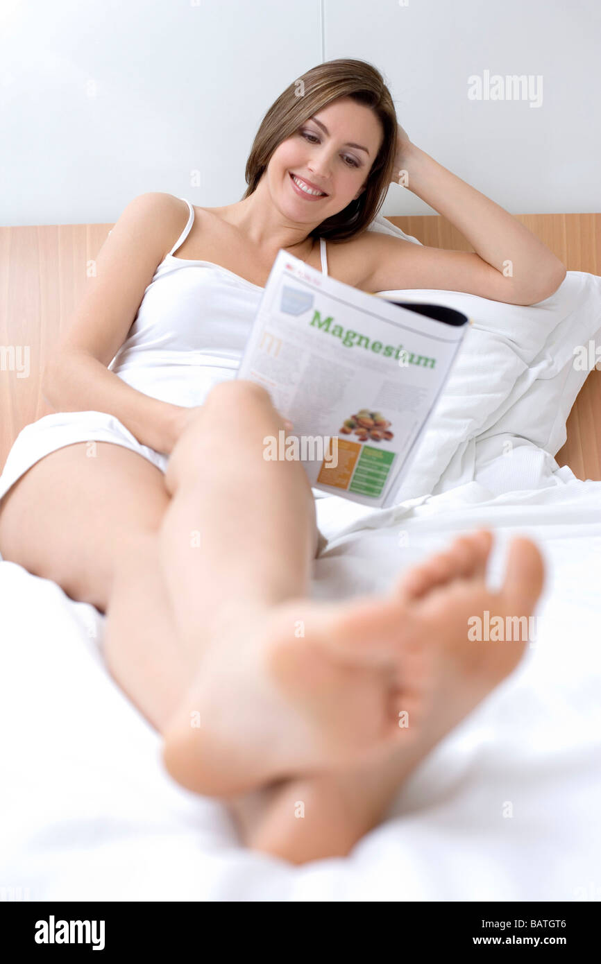 Image Of Sexy Woman Lies On Bed Indoors Dressed In Lingerie