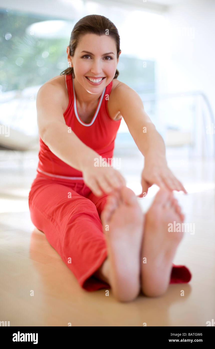 Woman touching her toes. - Stock Image