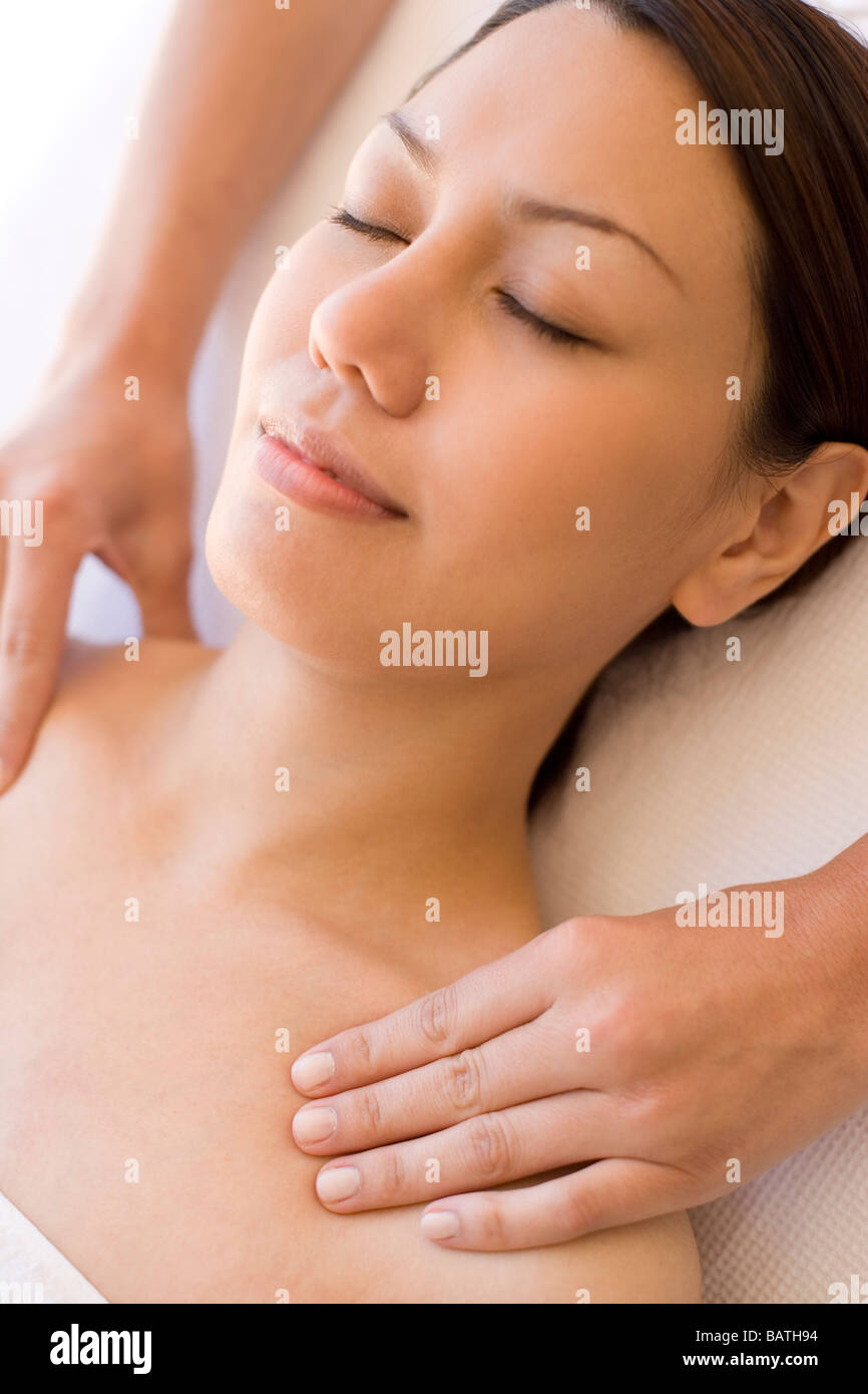 Massage. Woman receiving a shoulder massage. Stock Photo
