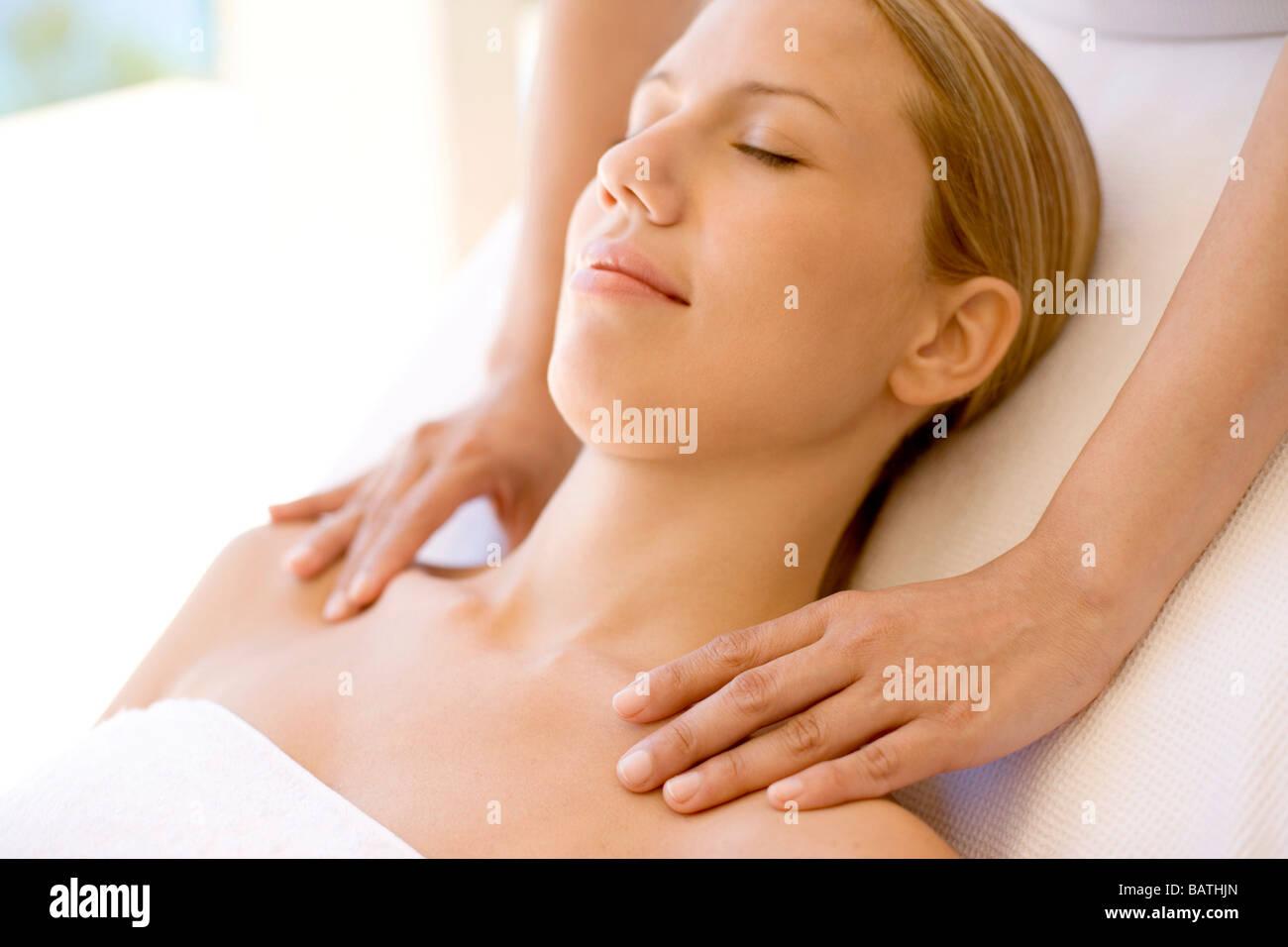 Massage. Woman receiving a temple massage. Stock Photo