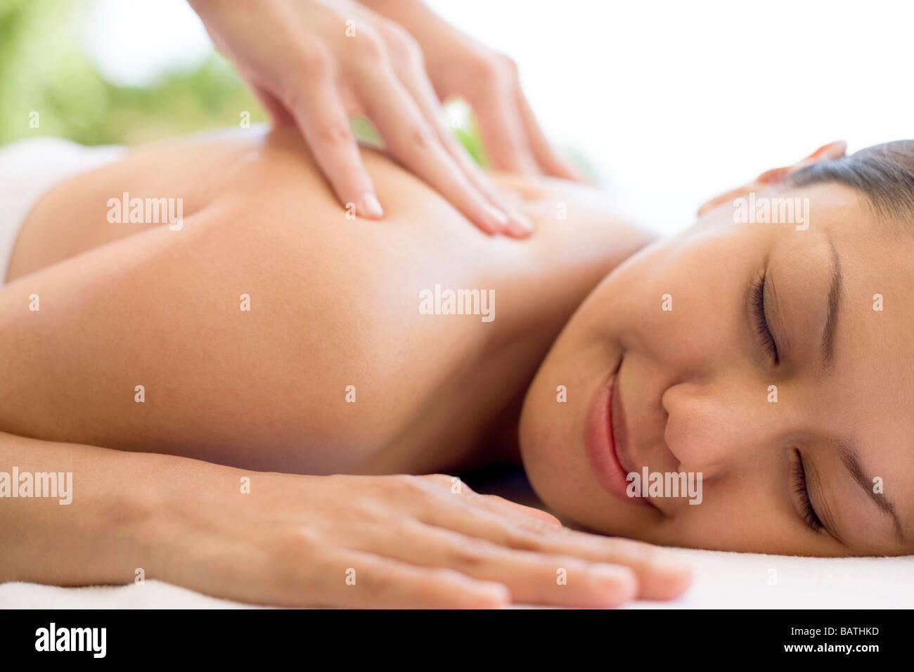 Massage. Woman receiving a shoulder massage. Stock Photo
