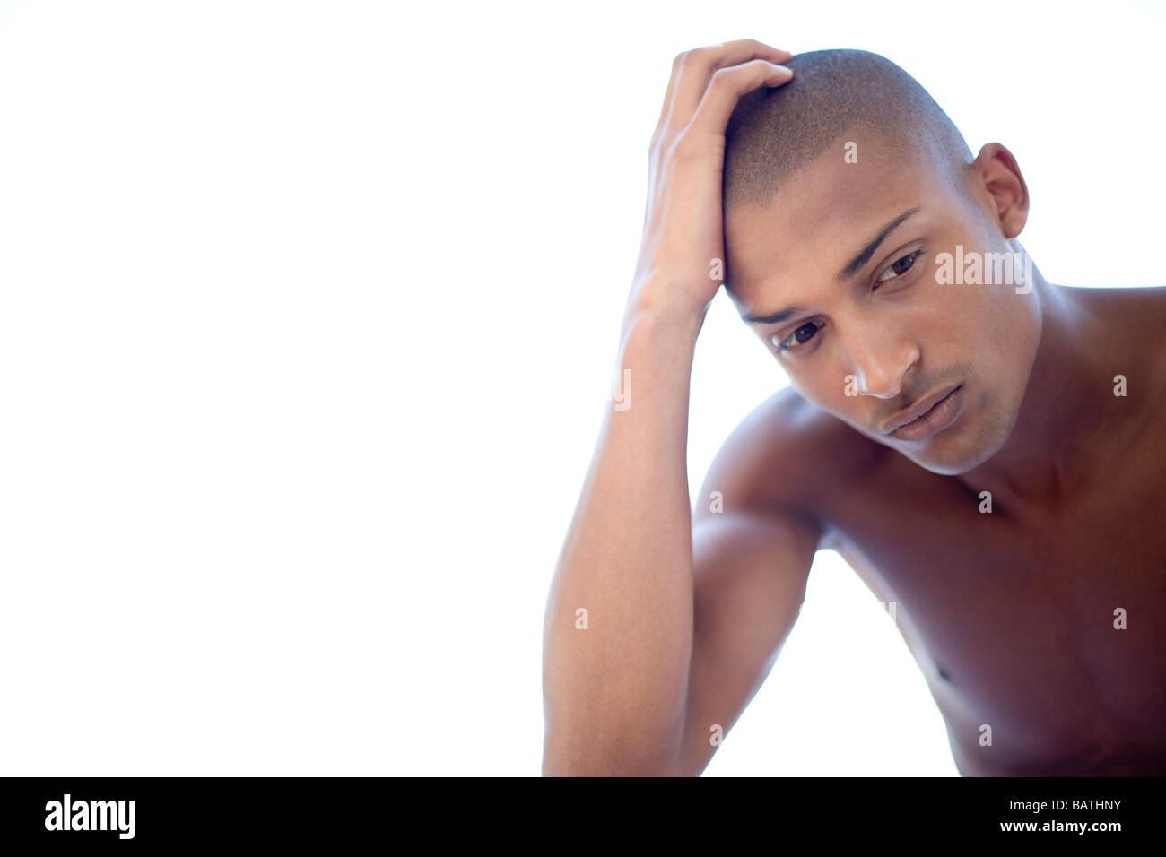 Depressed young man. He is twenty years old. - Stock Image