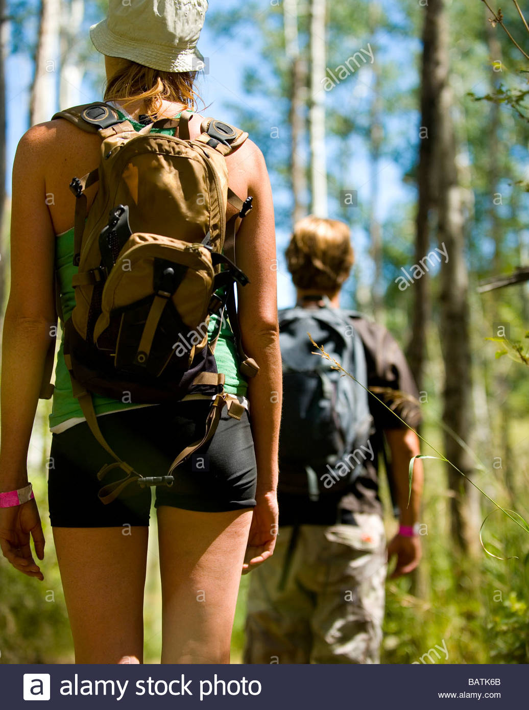 Couple hiking on forest trail - Stock Image