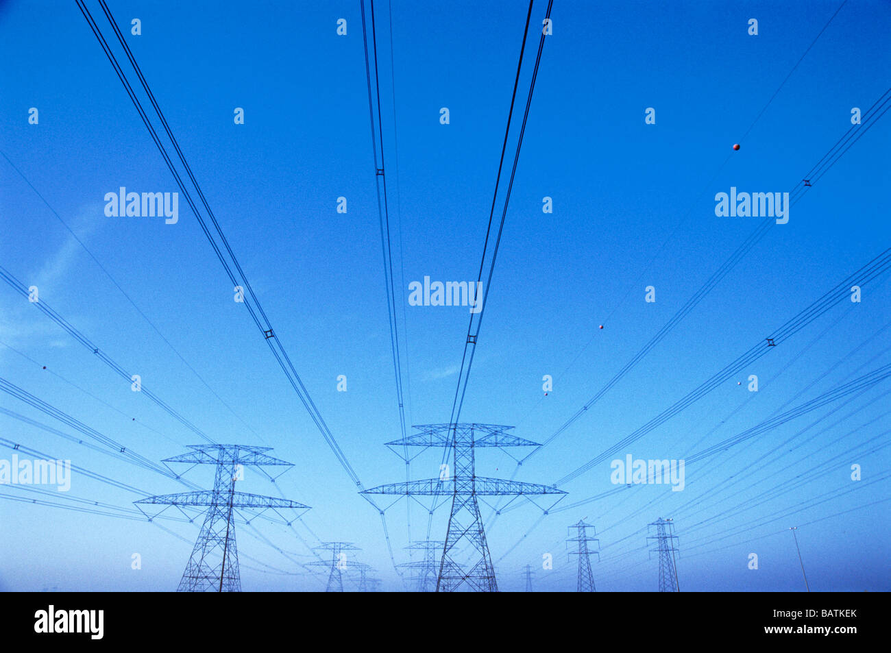 Power lines supported by electricity pylons. - Stock Image