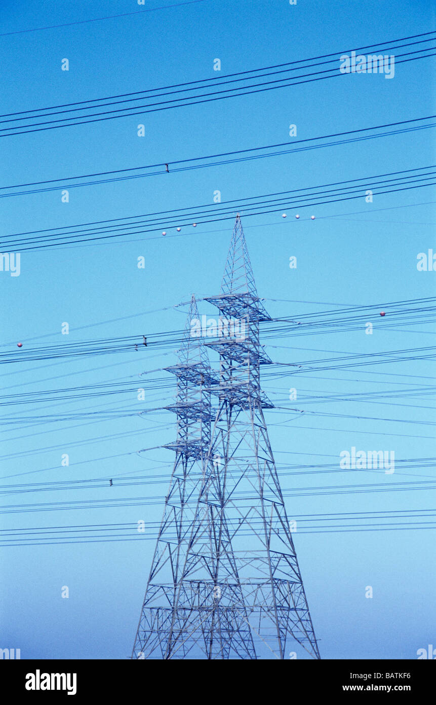 Electricity pylon supporting power lines. - Stock Image