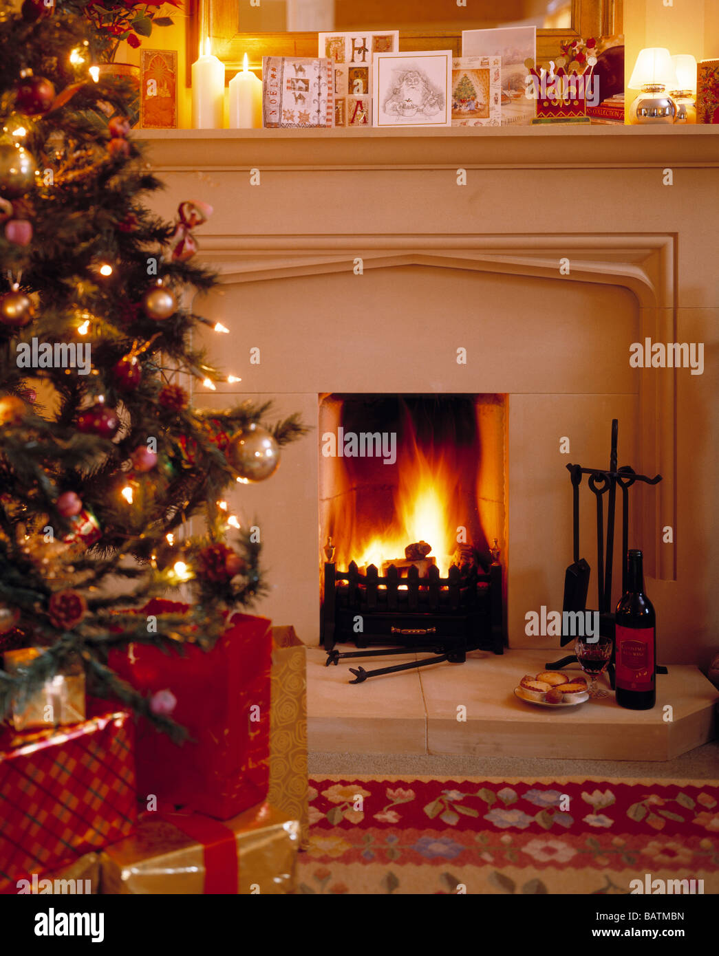 a warm and cosy christmas scene by the glowing fire stock photo
