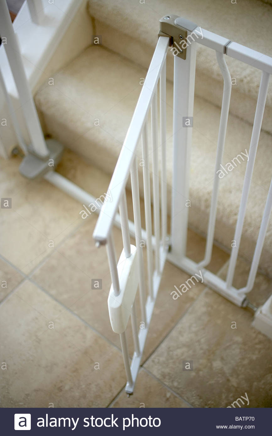 Close Up Of Open Childproof Gate At Foot Of Stairs