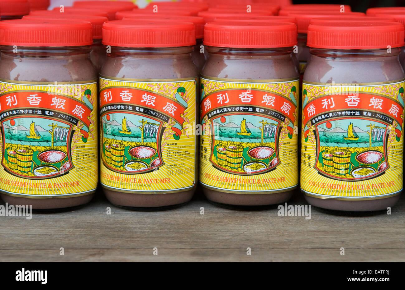 Jars of locally produced shrimp paste at the traditional fishing village of Tai O on Lantau Island Hong Kong. - Stock Image