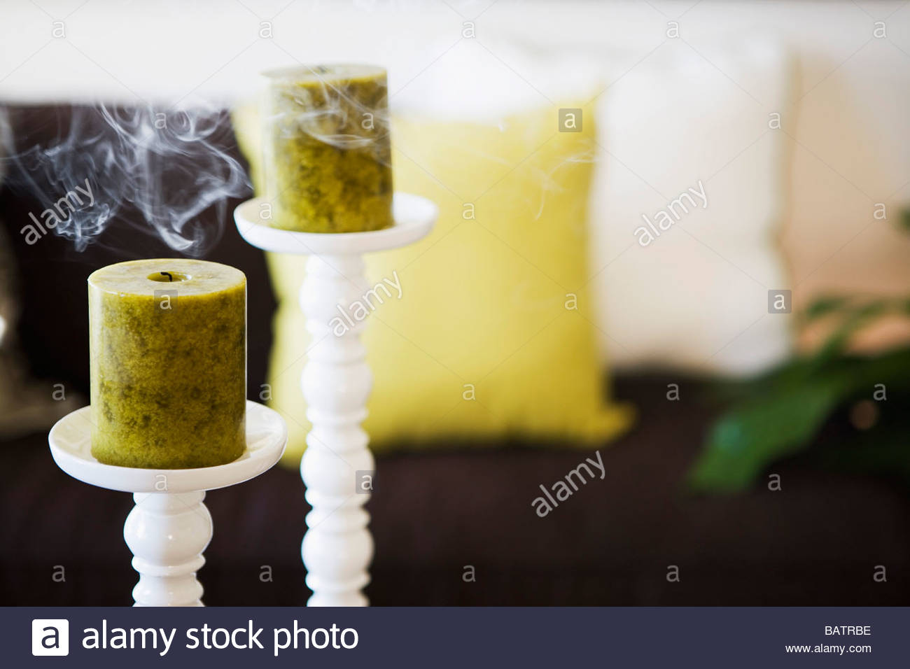 Two Unlit Candles with Smoke on Tall Candlesticks Stock Photo