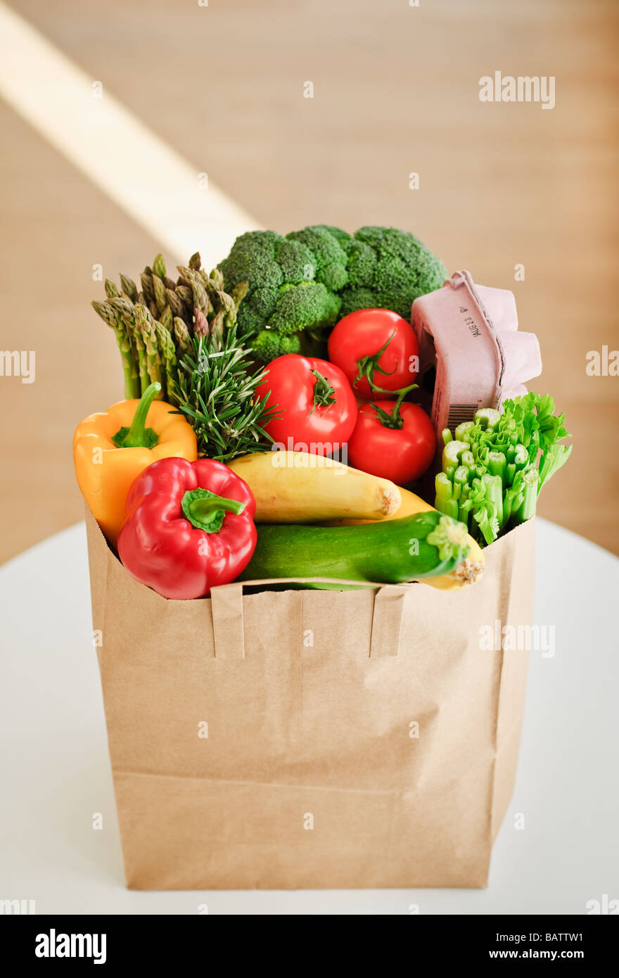Paper bag filled with vegetables - Stock Image