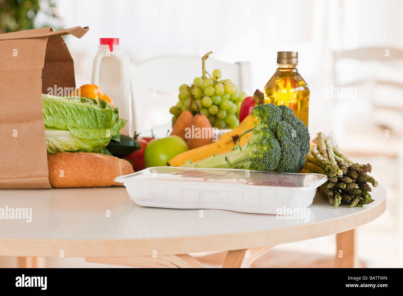 Paper bag filled with groceries - Stock Image