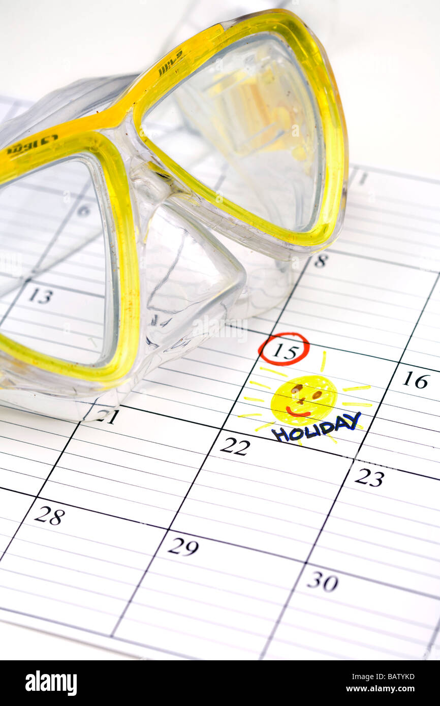 still life of diving goggles with holidays marked in calendar - Stock Image