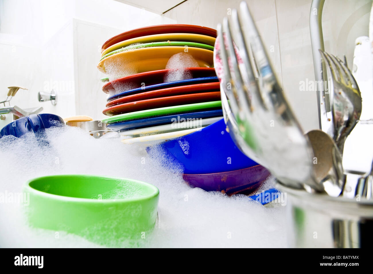 washing-up in kitchen sink - Stock Image