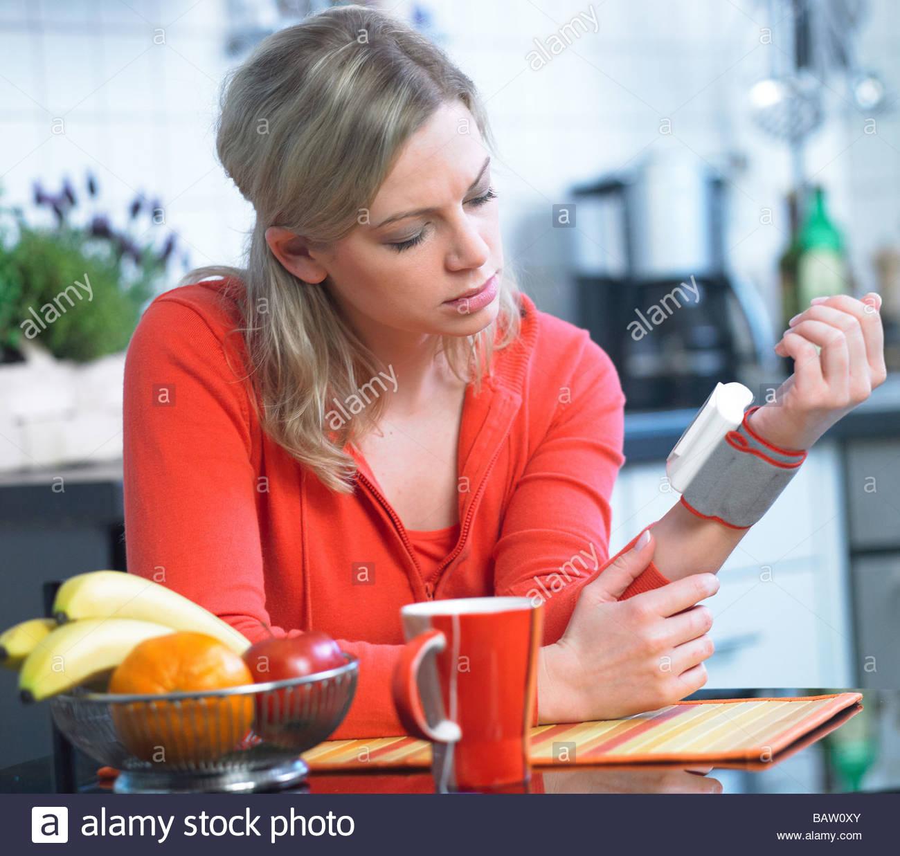 woman taking blood pressure - Stock Image