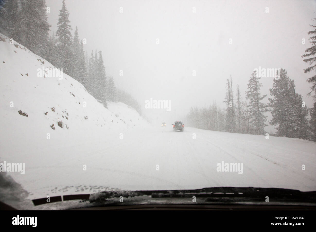 View from the driver s perspective of Route 9 between Breckenridge and Fairplay in a spring snow storm - Stock Image