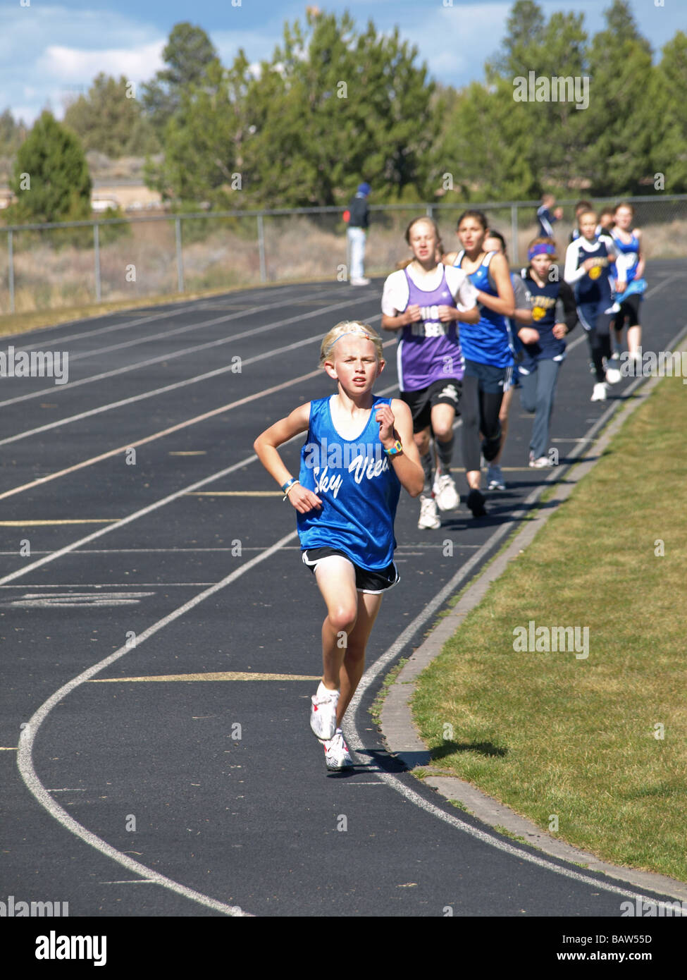 A 6th grader leads the 1500 meter race at a middle school track and field meet in Bend Oregon - Stock Image