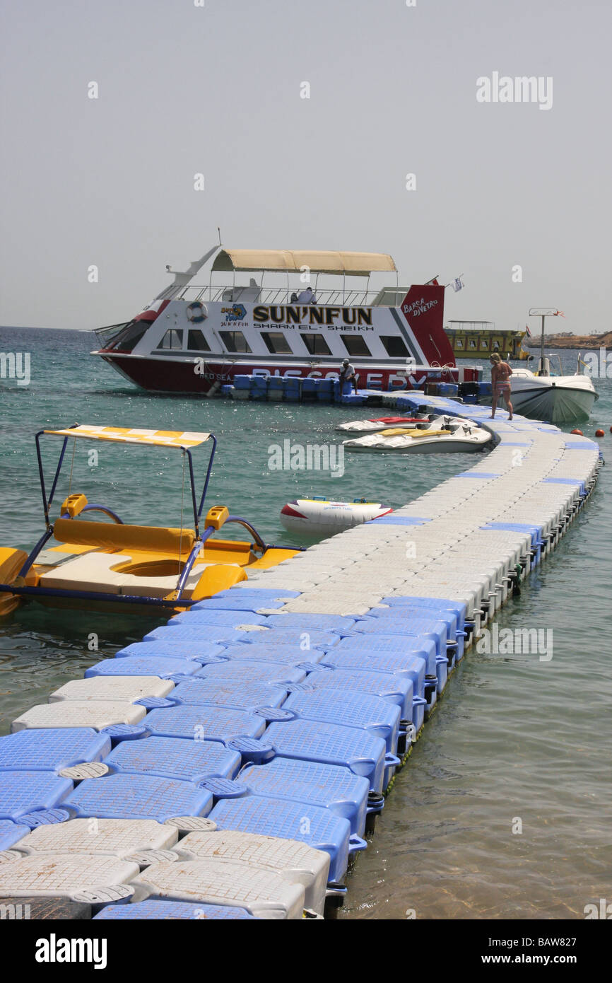 floating pier in sharm el sheikh with glass bottom boat and pedalos - Stock Image