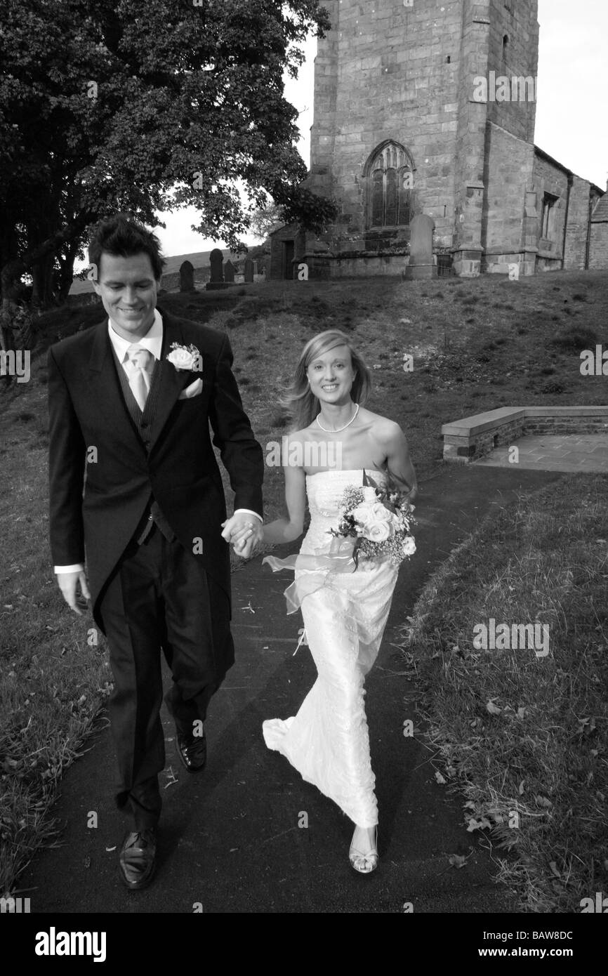 Young couple of newly weds just married at the church, North Yorkshire. UK MODEL RELEASED black & white image - Stock Image