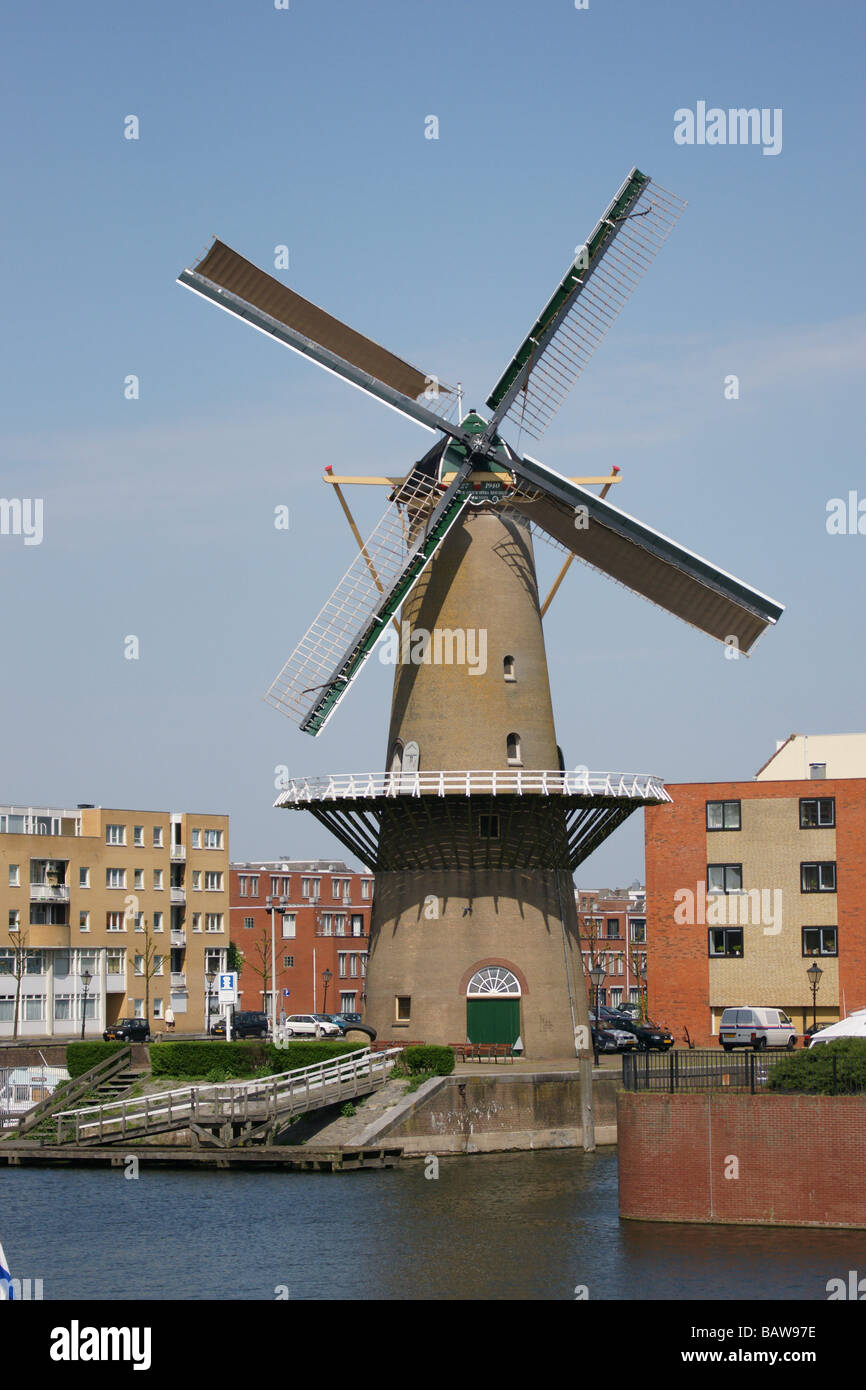 Schiedam part of Rotterdam, harbour and windmill and mooring yachts Stock Photo
