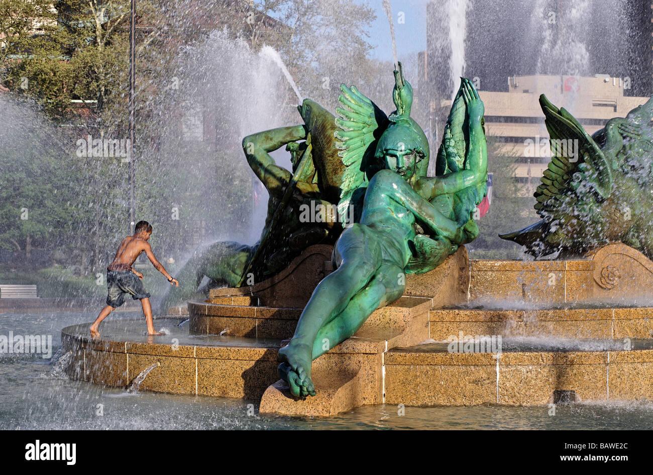Boy playing in Swann Fountain in Logan s Circle Philadelphia Pennsylvania - Stock Image