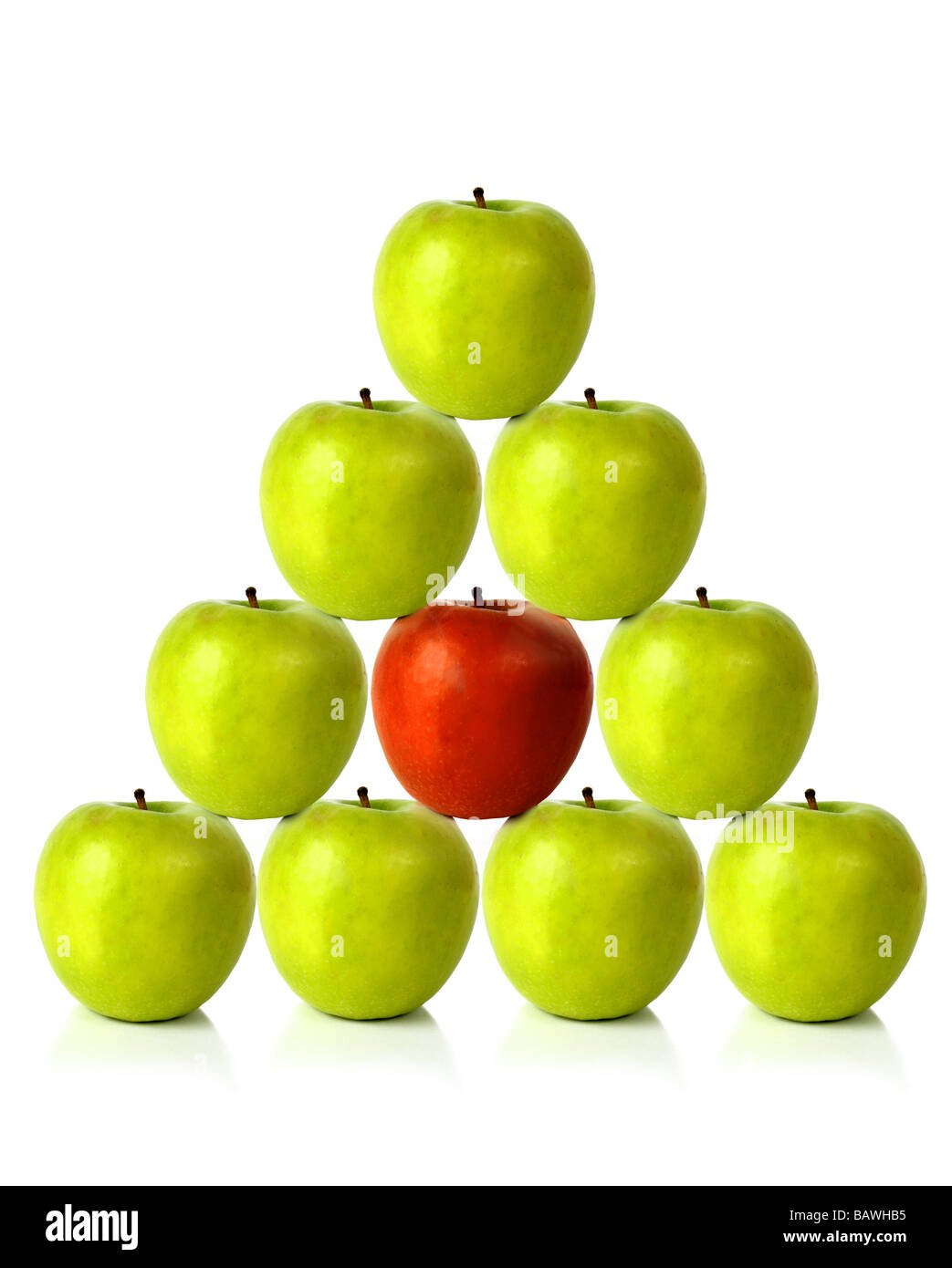 green apples on a pyramid shape - be different Stock Photo