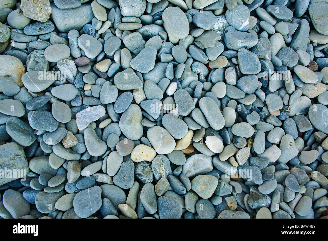 Pebbles on the beach - Stock Image