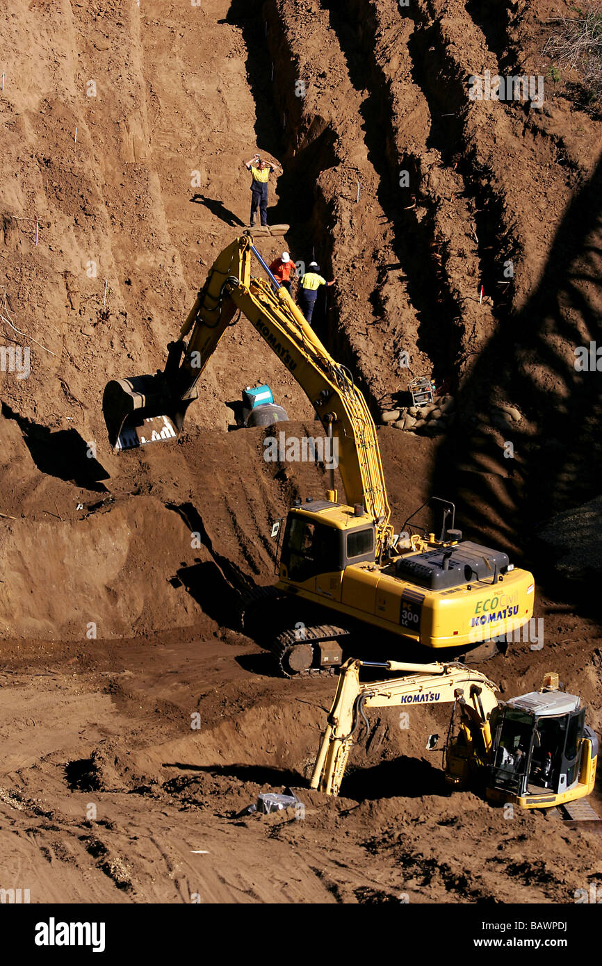 Construction workers excavating - Stock Image